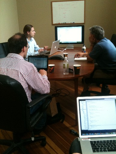 Ronald, Gregor, Lou, and Jim (out of sight, with laptop) hacking at Juxta Camp